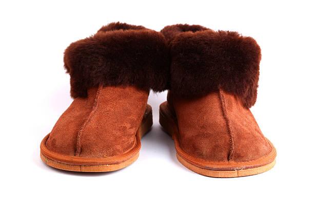 warme schuh - lammfellstiefel stock-fotos und bilder