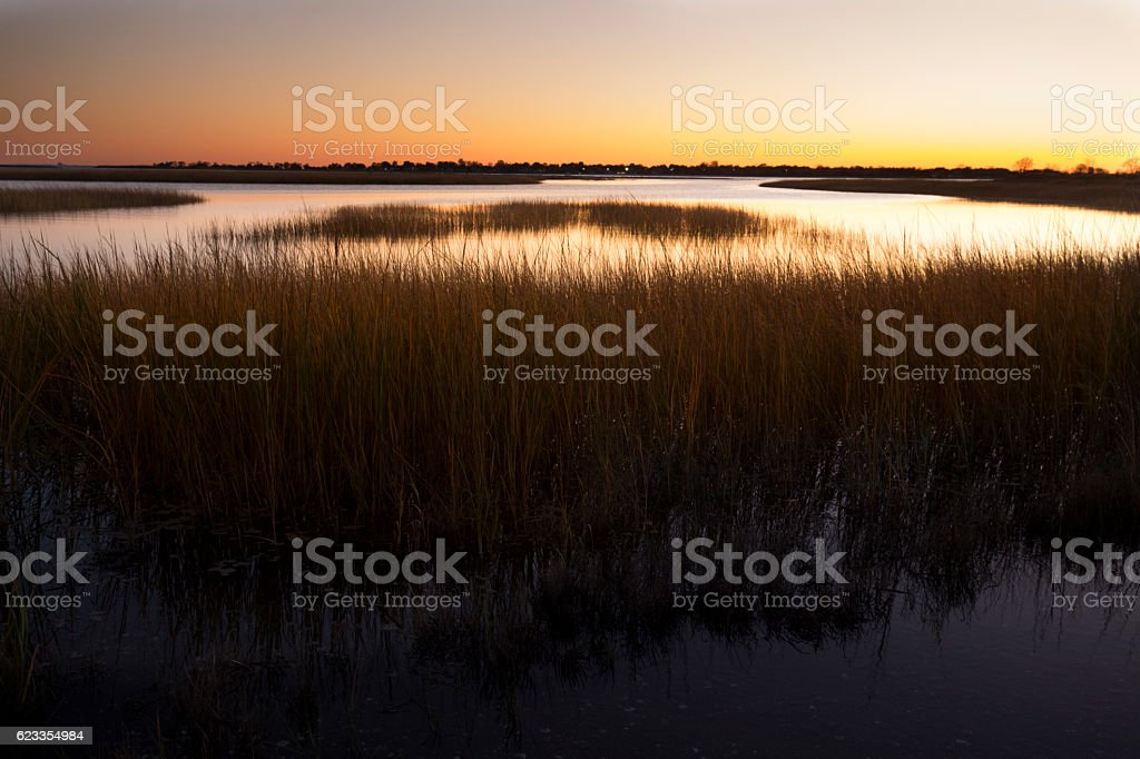 Warm sky over a marsh at Milford Point, Connecticut. stock photo