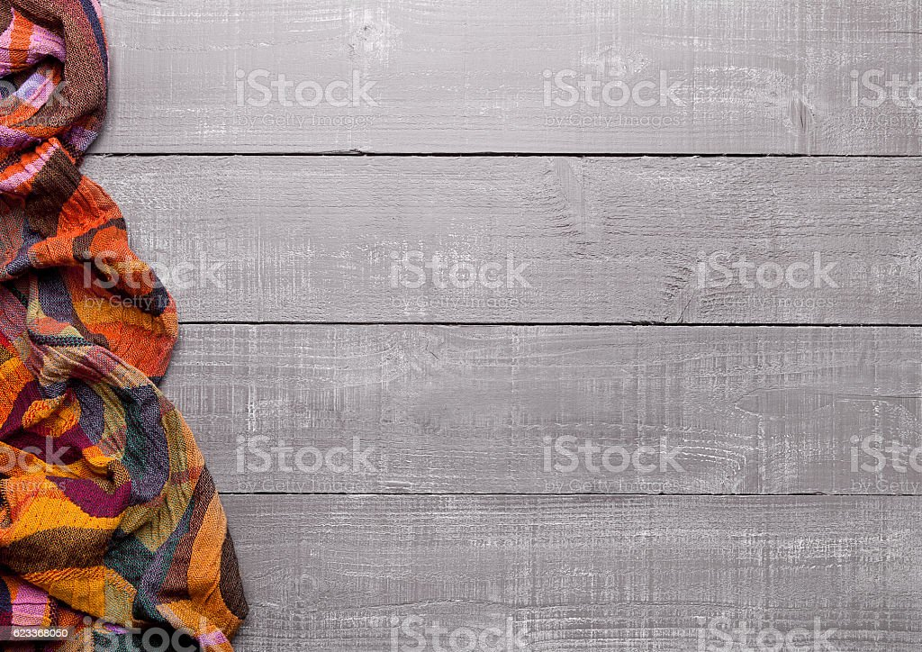 Warm soft wool scarf on wooden background texture stock photo