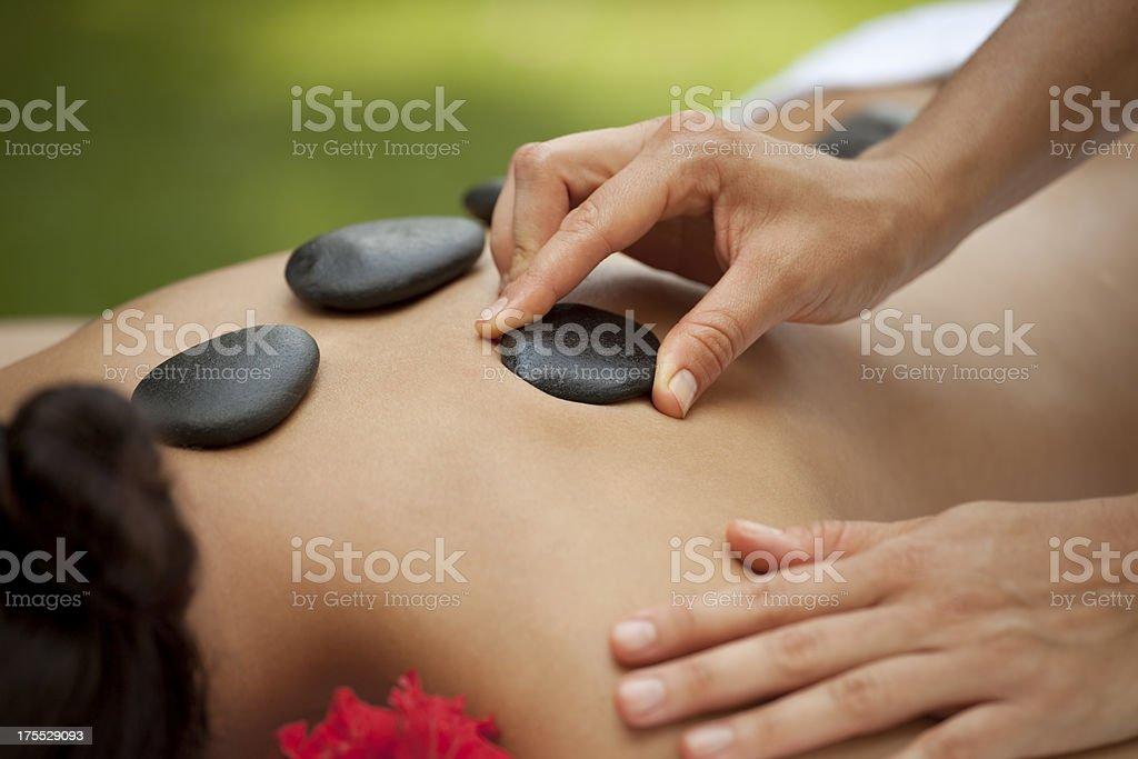 Warm stone massage at spa royalty-free stock photo