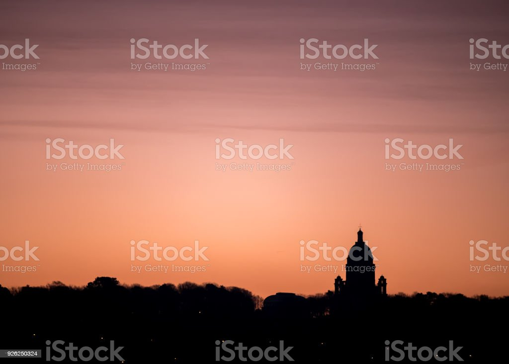Warm sunrise silhouettes Ashton Memorial building in Lancaster UK stock photo