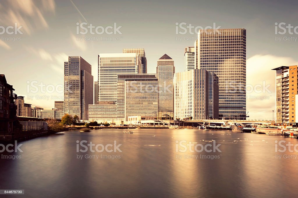 Warm sunset above Canary Wharf's skyline in London stock photo