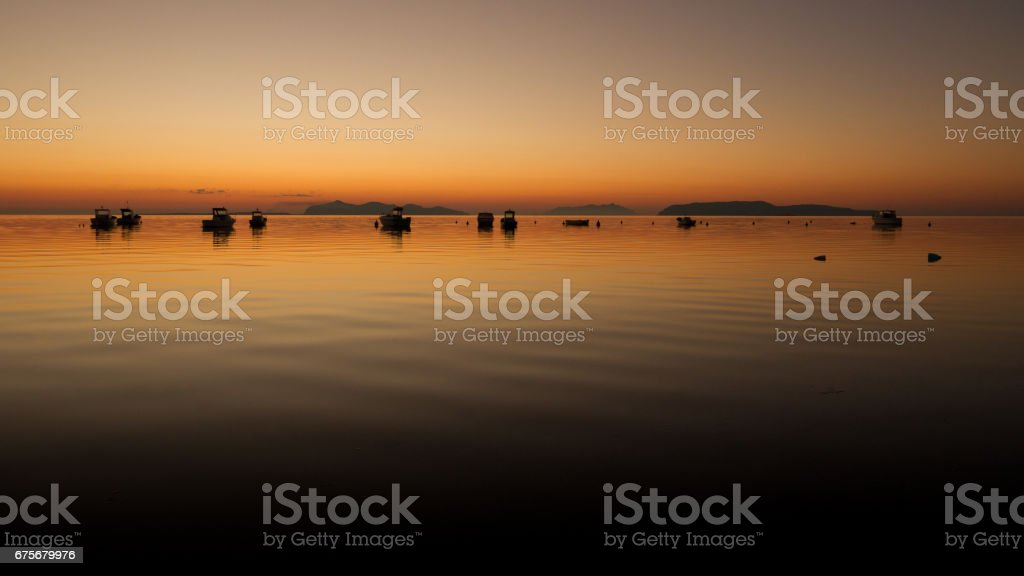 A warm sunset on a calm water royalty-free stock photo