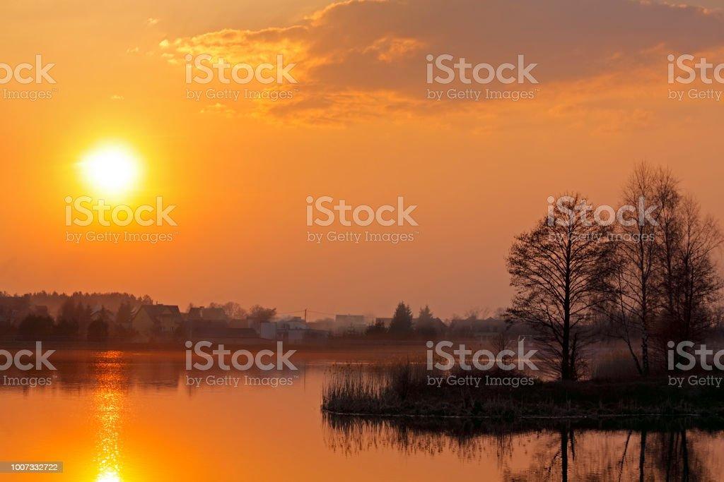 Warm sunset over lake stock photo