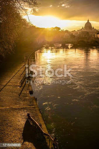 Rome, Italy -- A warm sunset over the golden waves of the Tiber river in the heart of the eternal city. Image in HD format.