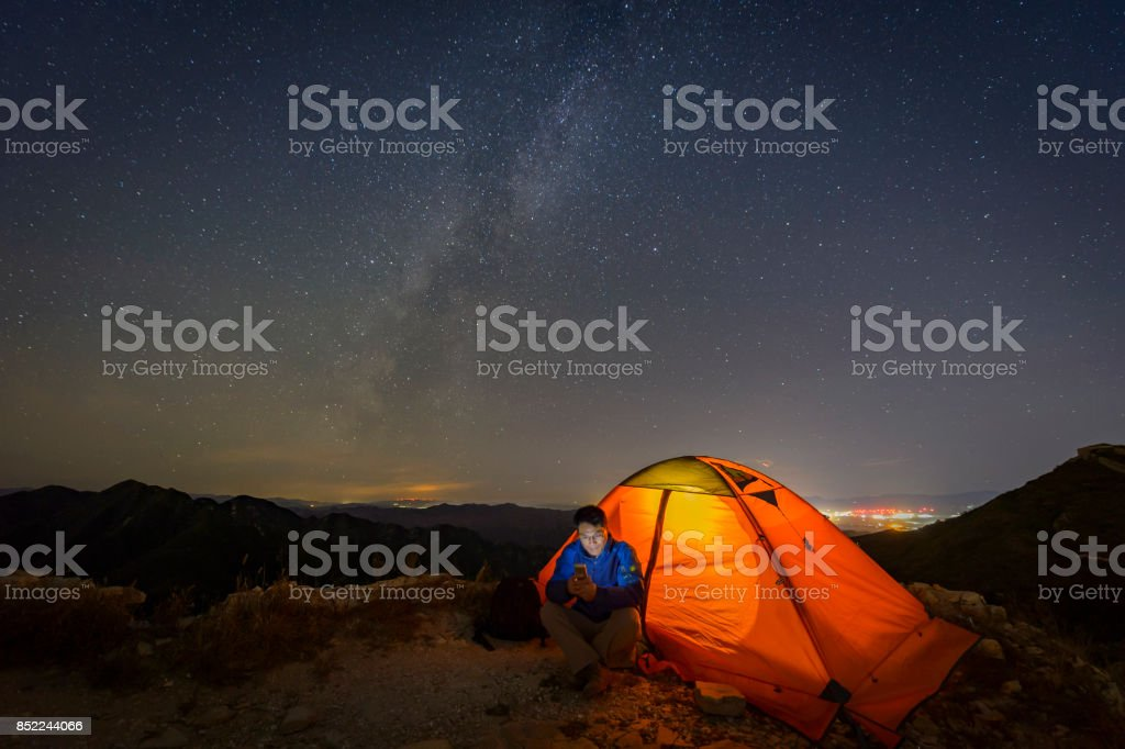 Warm tents under the Milky way, outdoor camping