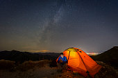 istock Warm tents under the Milky way, outdoor camping 852244066