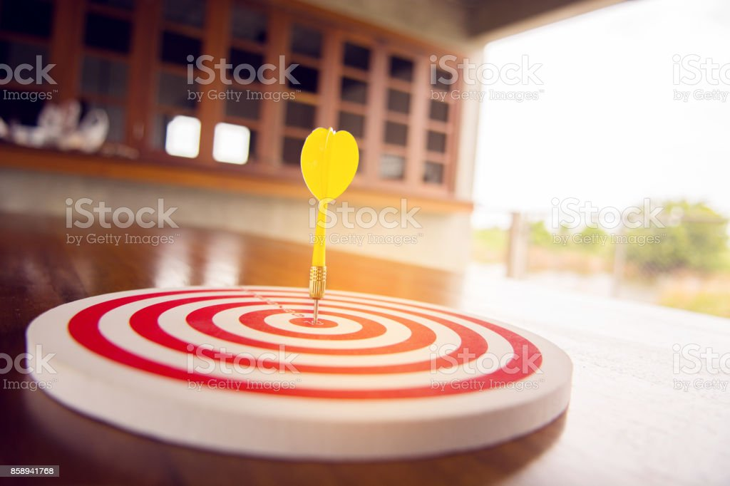 Warm tone of Circular target marked with numbers and dart. stock photo