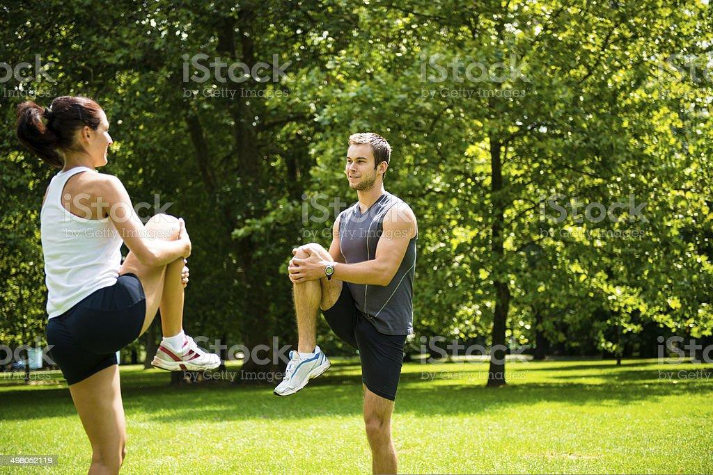 Warm up - couple exercising before jogging royalty-free stock photo