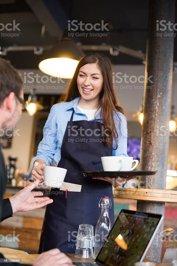 warm welcome to the cafe stock photo