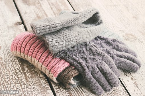 istock Warm winter knitted clothes - hat, scarf, gloves 627170404