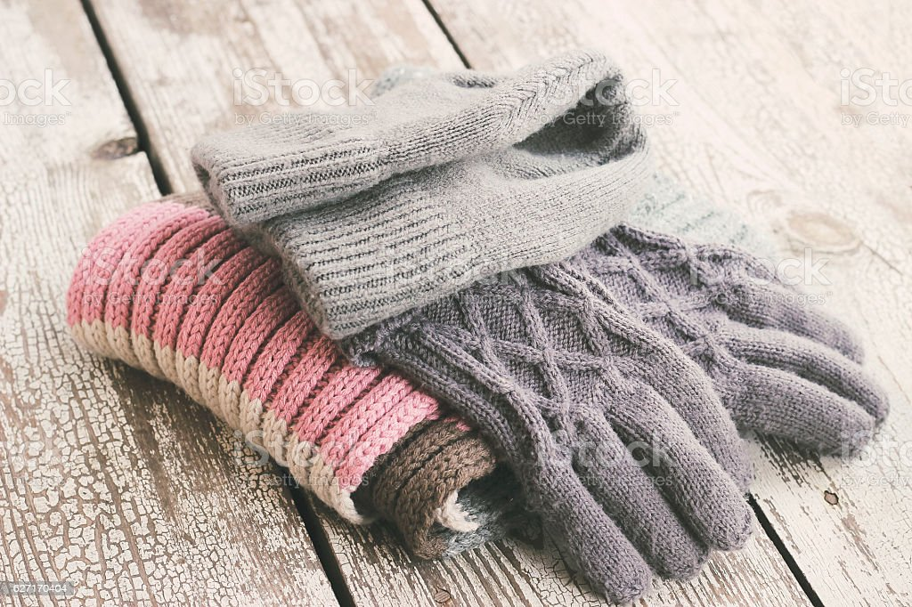 Warm winter knitted clothes - hat, scarf, gloves stock photo