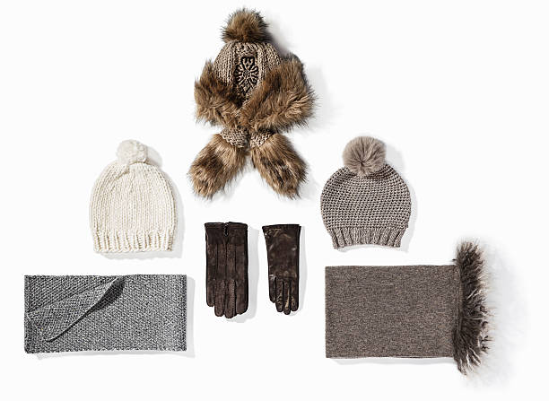 warm winter knitted clothes - hat, scarf, gloves - wollschal stock-fotos und bilder