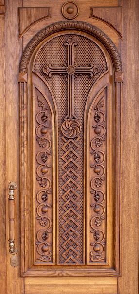 warm wooden door with crosses