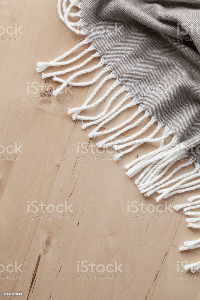 warm wool throw on wooden background stock photo