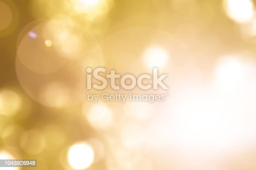 istock Warm yellow gold color of blurred sky background with nature glowing sun light flare and bokeh 1043926948