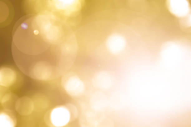 warm yellow gold color of blurred sky background with nature glowing sun light flare and bokeh - high key stock pictures, royalty-free photos & images