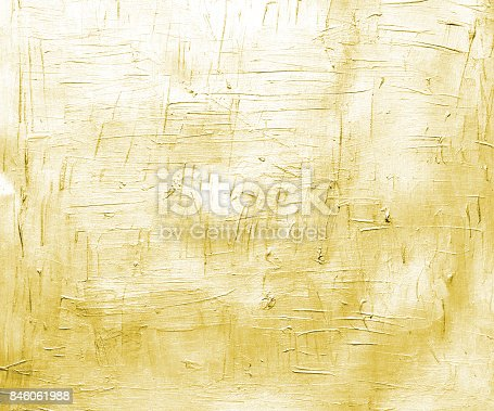 istock Warm yellow painted canvas with brush strokes. Metallic effect background for card or banner template 846061988