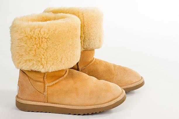 warm yellow women's boots. - lammfellstiefel stock-fotos und bilder