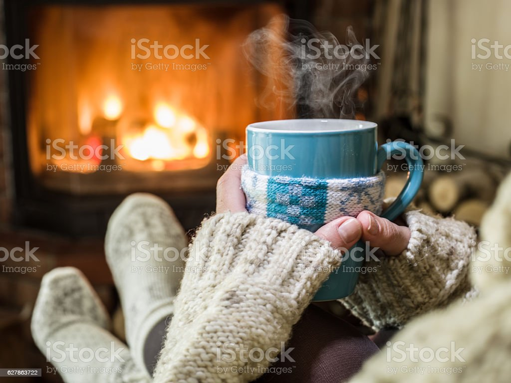 Warming and relaxing near fireplace. foto de stock libre de derechos