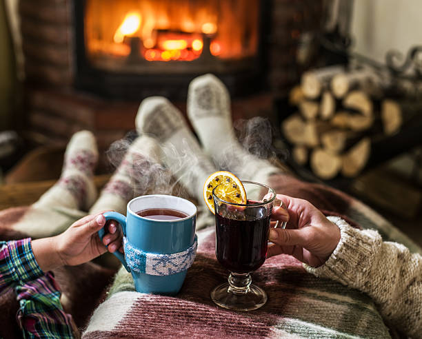 warming and relaxing near fireplace. - mulled wine stock photos and pictures