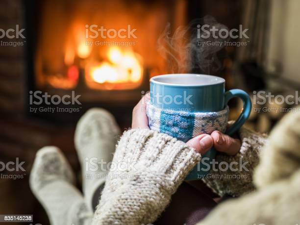 Warming and relaxing near fireplace with a cup of hot drink picture id835145238?b=1&k=6&m=835145238&s=612x612&h=jn00un4ossoiefqmcmqburfomb8trfrdb4ula6hishe=