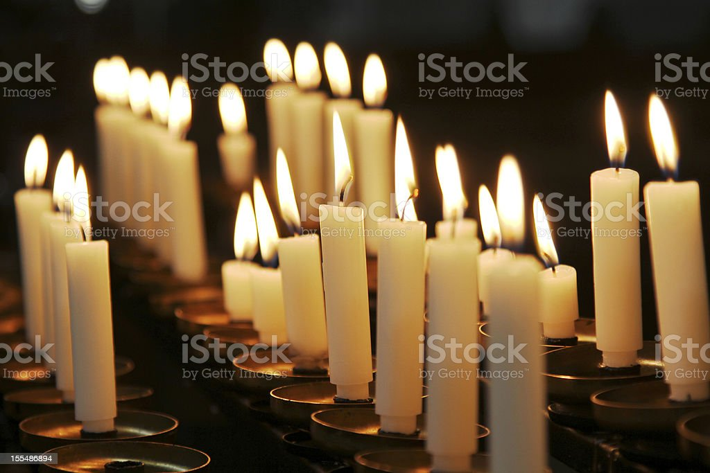 Warming candles in the dark. stock photo