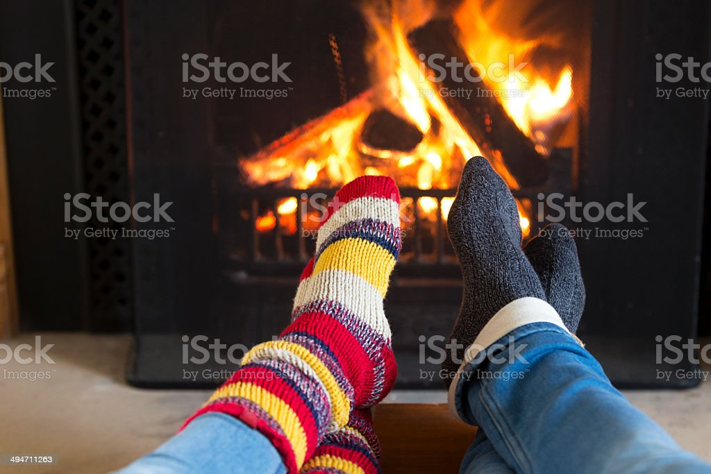 Warming Feet by the Fire stock photo