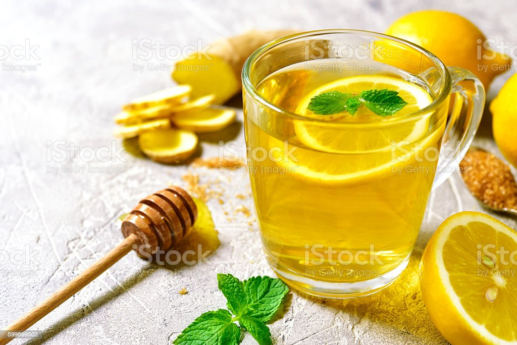 Warming ginger tea with lemon and mint stock photo