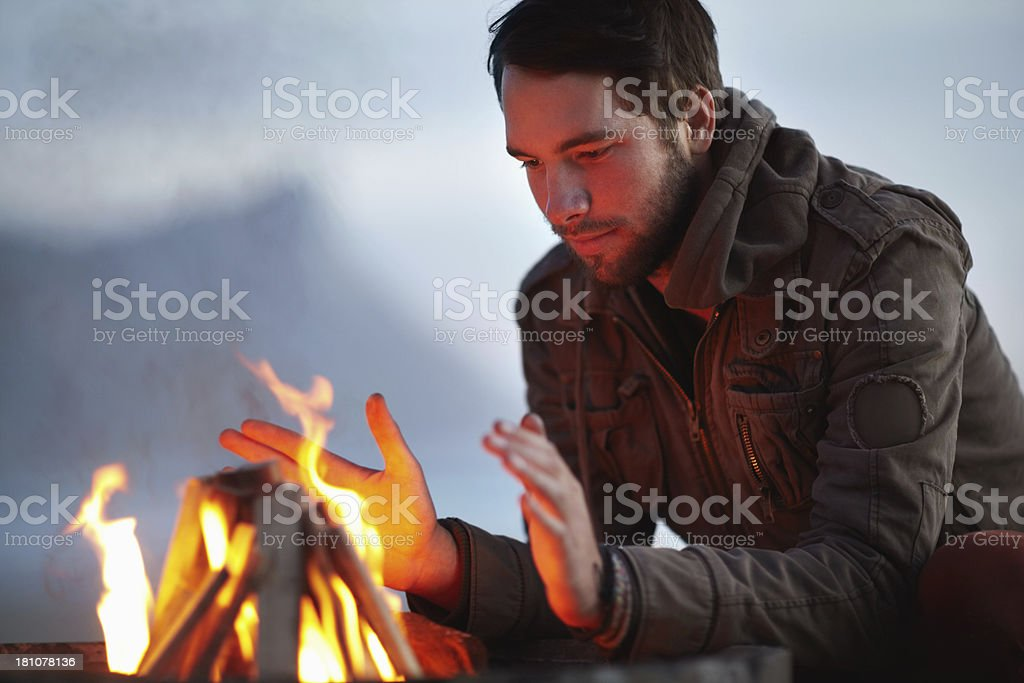 Warming himself at the flames royalty-free stock photo