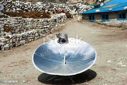 Warming the teapot in a solar cooker. Ecology concept. Renewable green energy. Nepal. Himalaya.