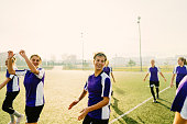 Photo of teenage girls warming up before the soccer match