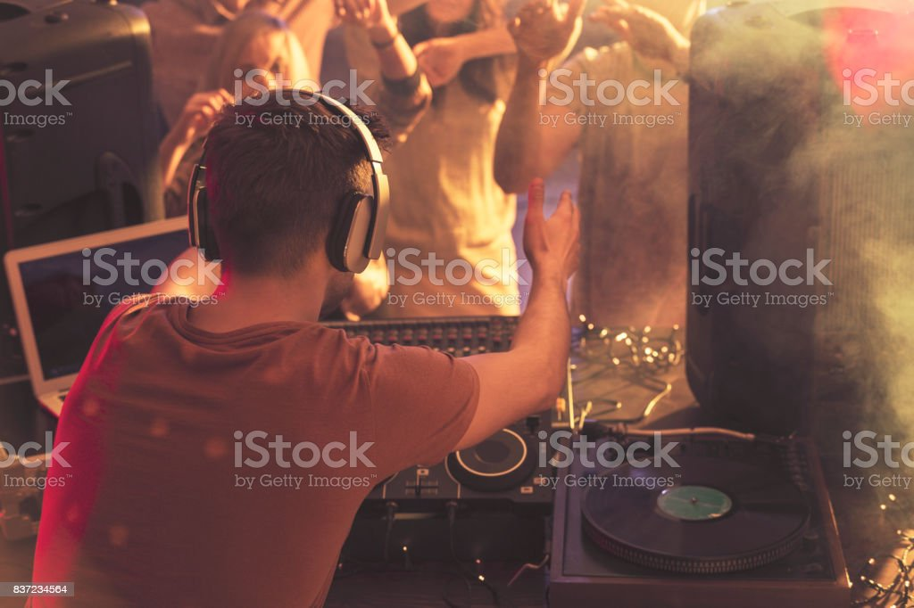 DJ warming up the audience stock photo