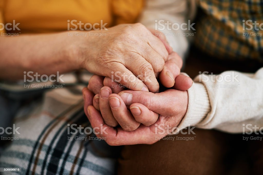 Warmness of loving hands stock photo