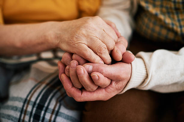 warmness of loving hands - senior valentine stock photos and pictures