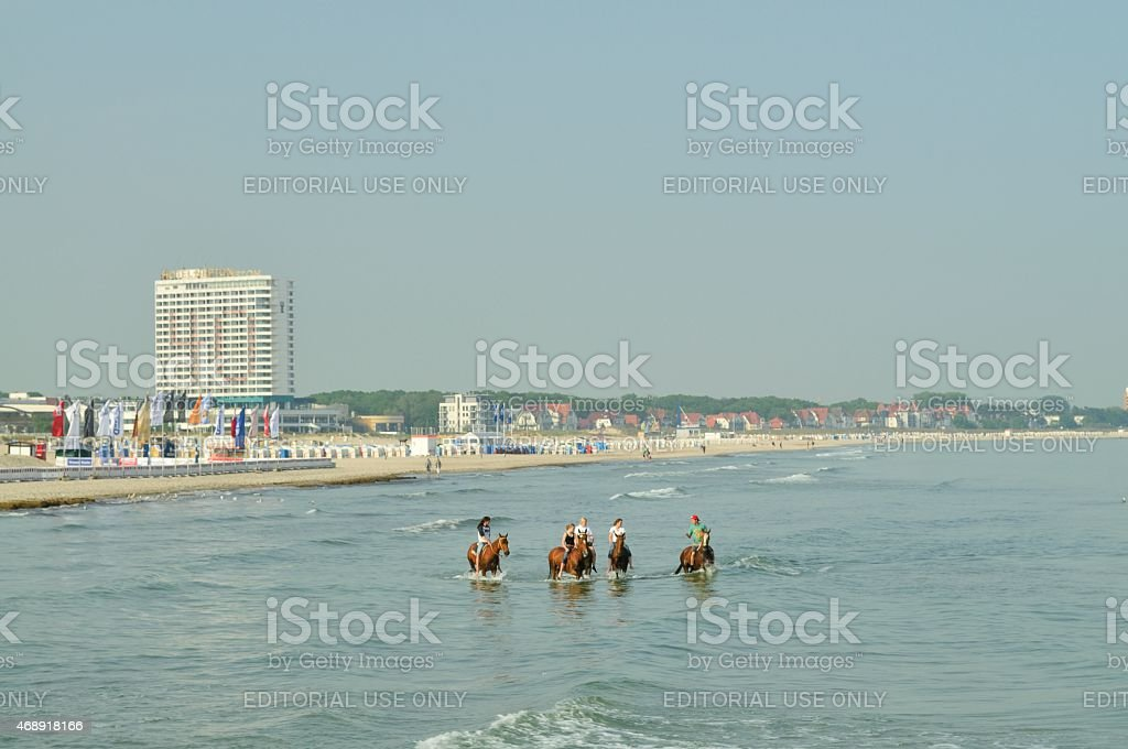 Warnemunde Horseback Riders In Baltic Sea stock photo