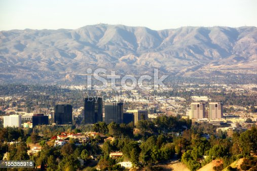 Santa Clarita Mountains in background as Warner Center in foreground with Woodland Hills, West Hills, Chatsworth, Norhtridge and Porter Ranch in between