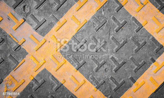 istock warning barricade lines on the pavement stretching into distance 577941514