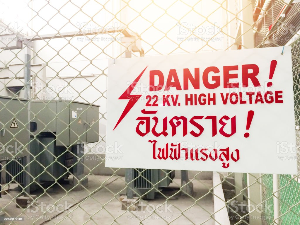 Warning danger high voltage sign and thai language mean danger high voltage also. A big red. 22 KV. high voltage. stock photo