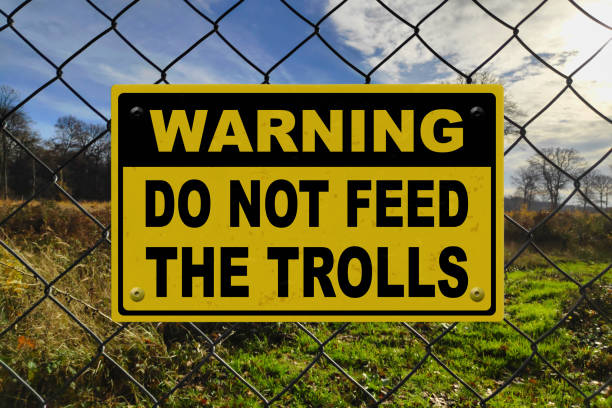 Warning - Do not feed the trolls stock photo