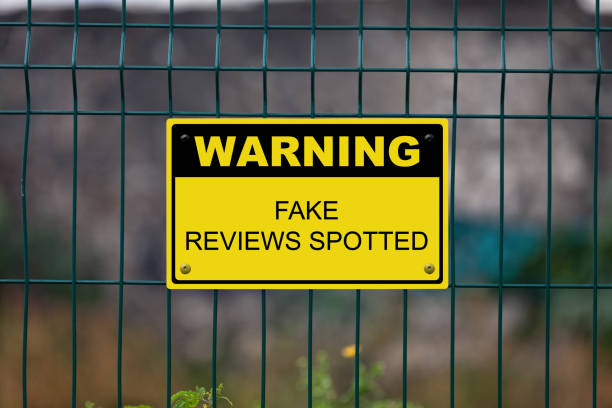 Warning - Fake reviews spotted stock photo