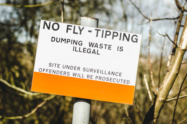 warning fly tipping sign stock photo