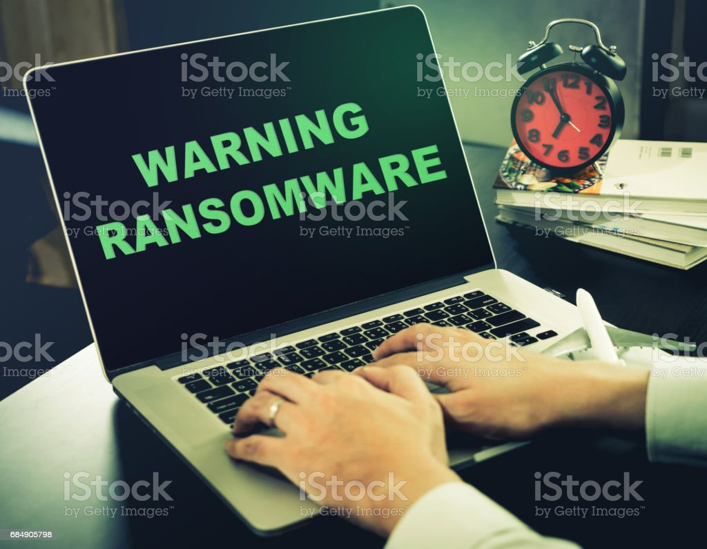 Warning for Ransomware on an office computer stock photo