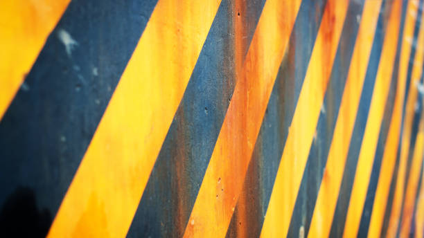 Warning hazard grunge rusty dirty pattern in yellow and black color, caution concept, Under construction concept stock photo