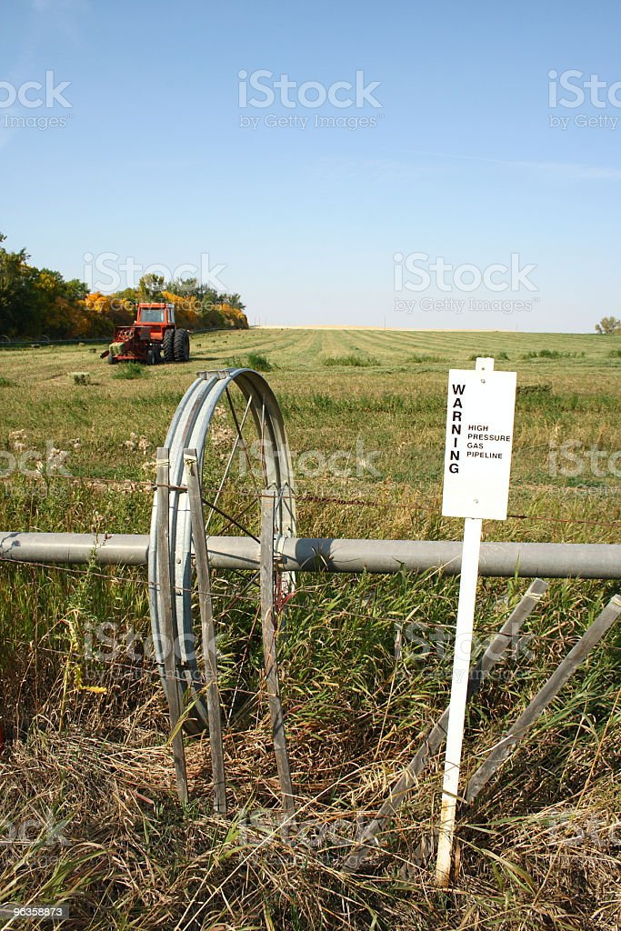 warning - high pressure gas pipeline sign in rural setting royalty-free stock photo
