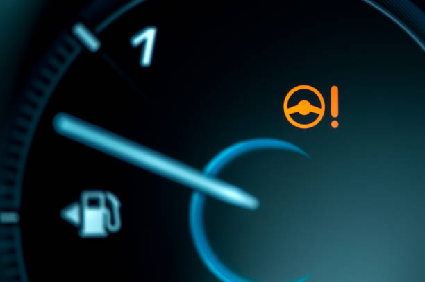 Warning light icon in car dashboard. Power steering failure stock photo