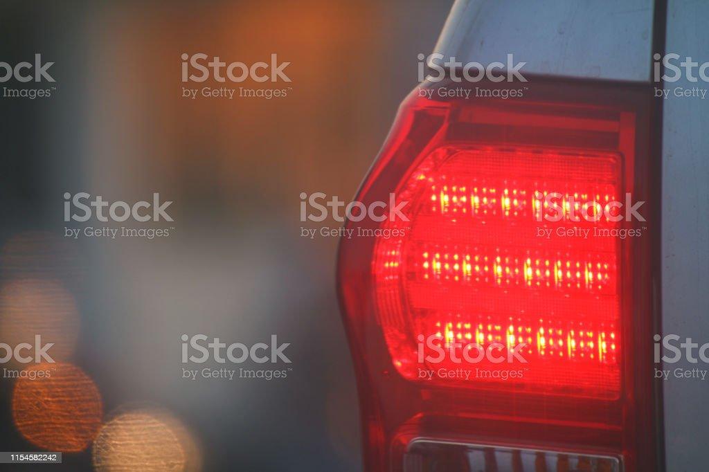 Warning light side back car evening, Brake lights of car back,...