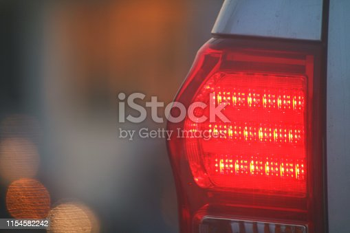 Warning light side back car evening, Brake lights of car back, Warning hazard lights car on the road traffic jam