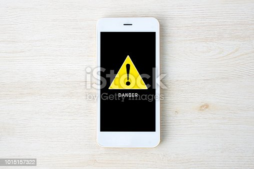 istock Warning mark on smart phone display 1015157322