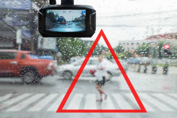Warning ,pedestrian running cut the car off in the rain stock photo